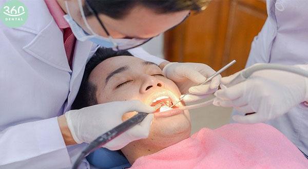 lấy cao răng có hại không
